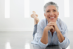 Older woman smiling for the camera, showing off her healthy gums