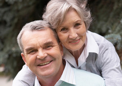 Older couple with white, attractive smiles
